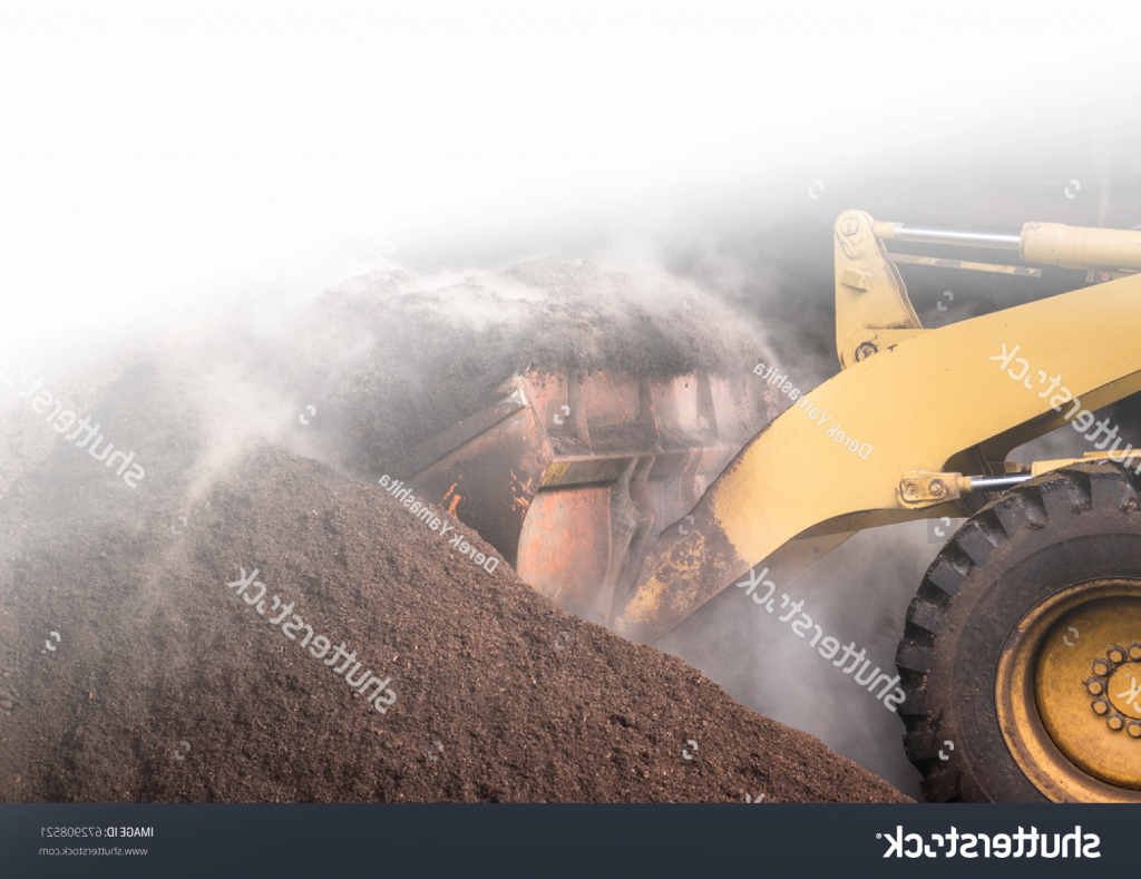 stock-photo-a-large-compost-pile-being-churned-by-a-bulldozer-672908521